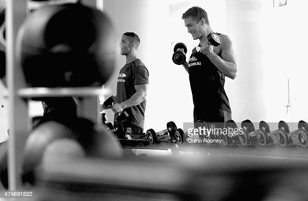 Tom McDonald lifts weights during a Melbourne Demons AFL training session at AAMI Park on May 25 2015 in Melbourne Australia