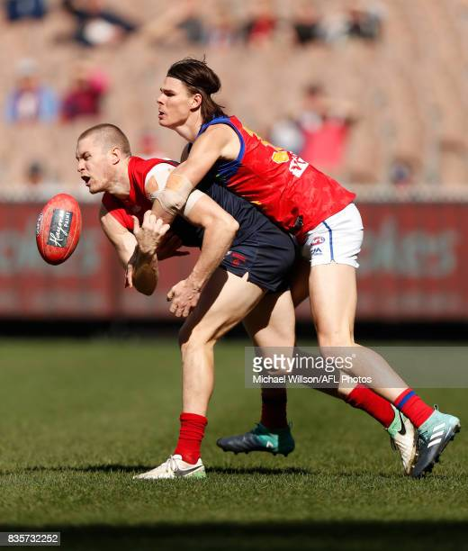 Tom McDonald of the Demons and Eric Hipwood of the Lions compete for the ball during the 2017 AFL round 22 match between the Melbourne Demons and the...