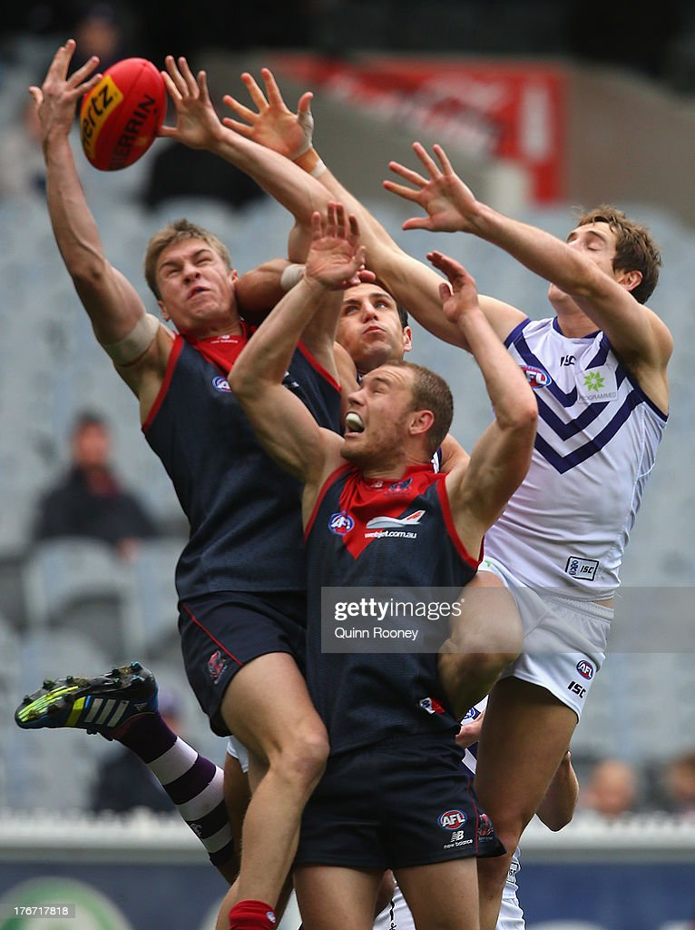 Tom McDonald of the Demons attempts to mark during the round 21 AFL match between the Melbourne Demons and the Fremantle Dockers at Melbourne Cricket Ground on August 18, 2013 in Melbourne, Australia.