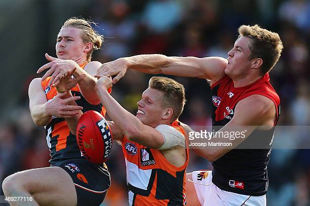 Tom McDonald of the Demons Cam McCarthy and Adam Treloar of the Giants contest for the ball during the round two AFL match between the Greater...