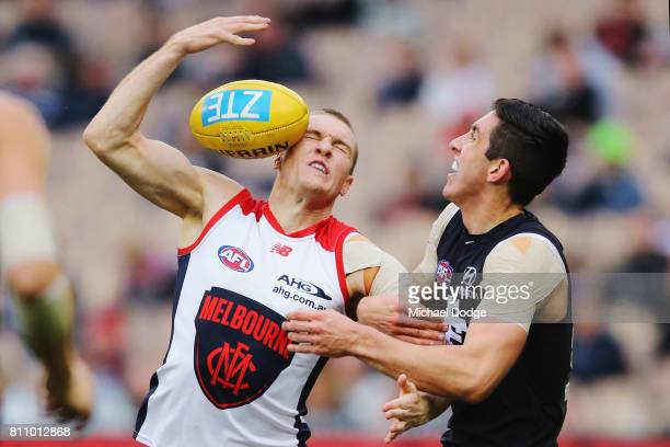 Tom McDonald of the Demons compete for the ball against Jacob Weitering of the Blues during the round 16 AFL match between the Carlton Blues and the...