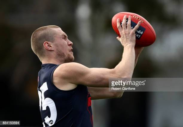 Tom McDonald of the Demons handballs during a Melbourne Demons AFL training session at Gosch's Paddock on August 18 2017 in Melbourne Australia