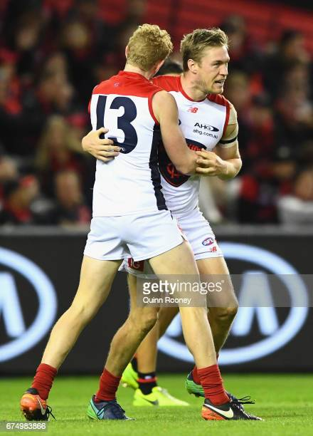 Tom McDonald of the Demons is congratulated by Clayton Oliver after kicking a goal during the round six AFL match between the Essendon Bombers and...