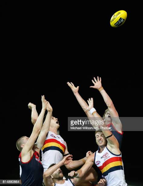Tom McDonald of the Demons Jake Lever of the Crows Brodie Smith of the Crows Daniel Talia of the Crows and Mitch Hannan of the Demons compete for the...