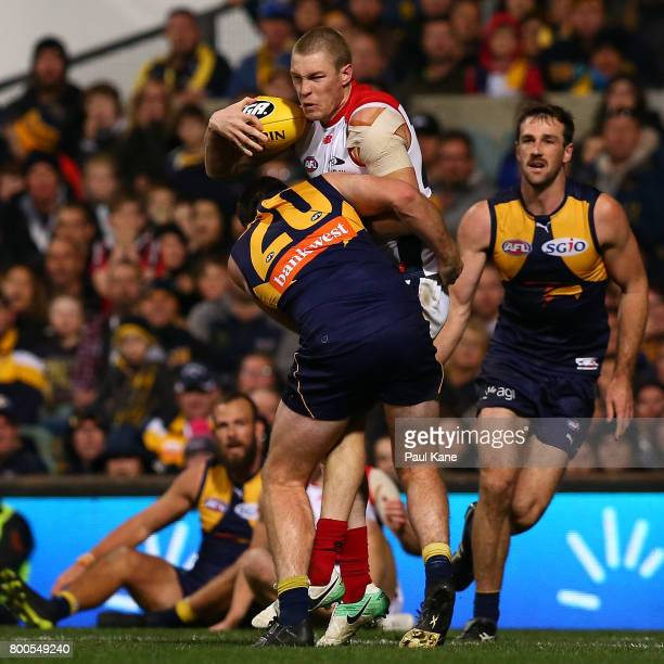 Tom McDonald of the Demons looks to break from a tackle by Jeremy McGovern of the Eagles during the round 14 AFL match between the West Coast Eagles...