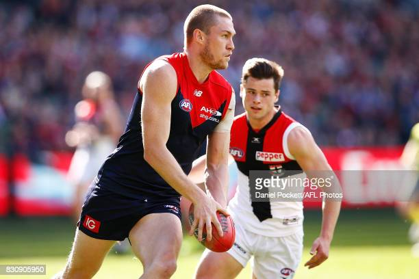Tom McDonald of the Demons runs with the ball during the round 21 AFL match between the Melbourne Demons and the St Kilda Saints at Melbourne Cricket...
