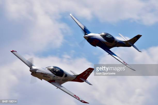 Tom McNerney pilot of the Lancair 360 'Unleashed' leads Louis Gabriel in the Lancair 360 'Blind Luck' in the Sport Class heat race at the 54th...