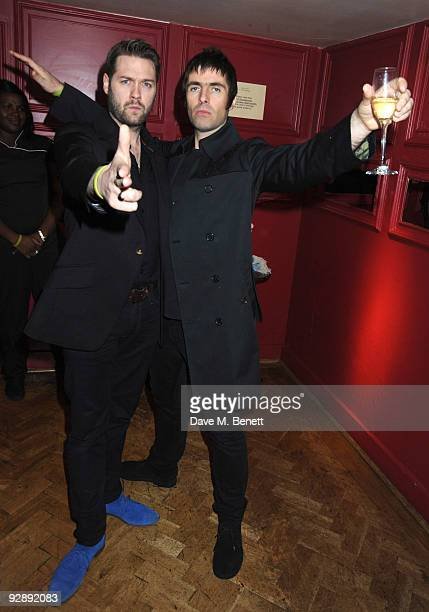 Tom Meighan and Liam Gallagher attend the launch of Liam Gallaghers clothing line Pretty Green at the Gore Hotel on November 7 2009 in London England
