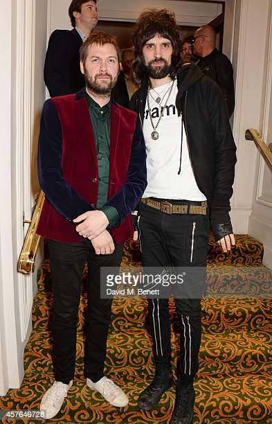 Tom Meighan and Serge Pizzorno of Kasabian arrive at the Xperia Access Q Awards at The Grosvenor House Hotel on October 22 2014 in London England
