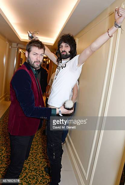 Tom Meighan and Serge Pizzorno of Kasabian winners of the Best Act In The World Today award pose in the press room at the Xperia Access Q Awards at...