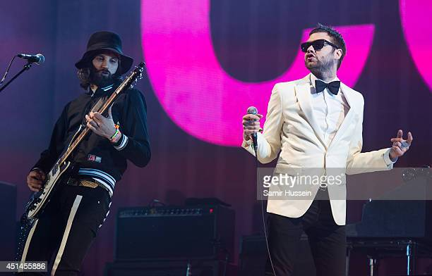 Tom Meighan and Sergio Pizzorno of Kasabian perform as the band headline the Pyramid stage on Day 3 of the Glastonbury Festival at Worthy Farm on...