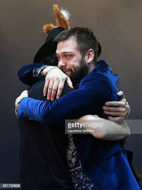 Tom Meighan and Sergio Pizzorno of Kasabian perform during the Leicester City Barclays Premier League winners bus parade on May 16 2016 in Leicester...
