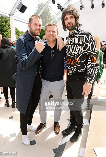 Tom Meighan Dermot O'Leary and Serge Pizzorno attend the front row at Burberry Menswear Spring/Summer 2016 show at Kensington Gardens on June 15 2015...