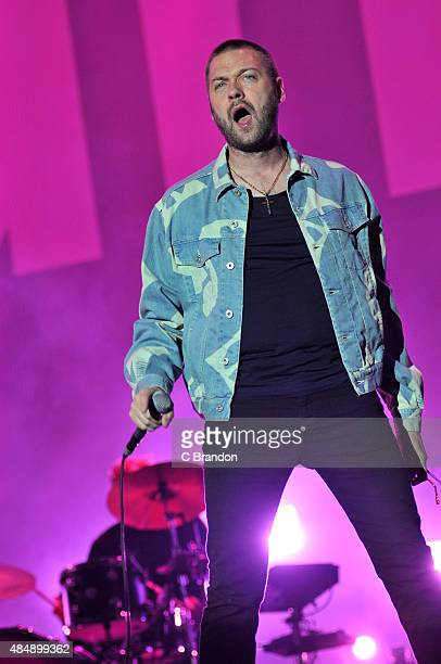 Tom Meighan of Kasabian headlines on the Virgin Media stage during Day 1 of the V Festival at Hylands Park on August 22 2015 in Chelmsford England