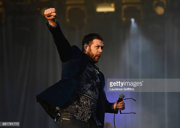 Tom Meighan of Kasabian performs during the Leicester City Barclays Premier League winners bus parade on May 16 2016 in Leicester England