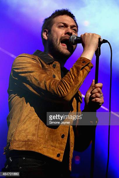 Tom Meighan of Kasabian performs live on stage for iTunes Festival at The Roundhouse on September 5 2014 in London United Kingdom