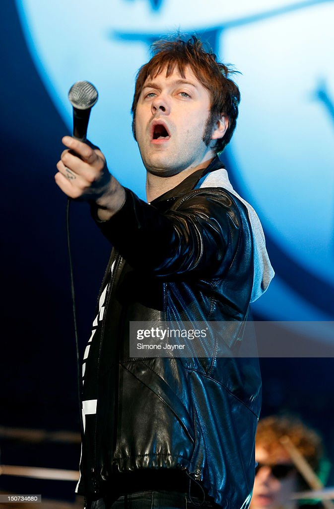 <a gi-track='captionPersonalityLinkClicked' href=/galleries/search?phrase=Tom+Meighan&family=editorial&specificpeople=210642 ng-click='$event.stopPropagation()'>Tom Meighan</a> of Kasabian performs live on the Main Stage on Day Two during the Reading Festival 2012 at Richfield Avenue on August 25, 2012 in Reading, England.