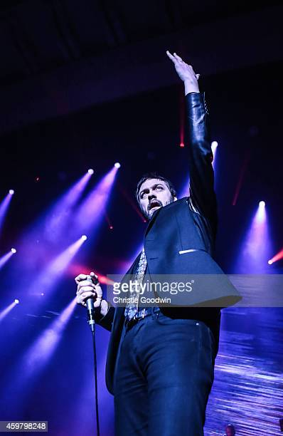 Tom Meighan of Kasabian performs on stage at Brixton Academy on December 1 2014 in London United Kingdom