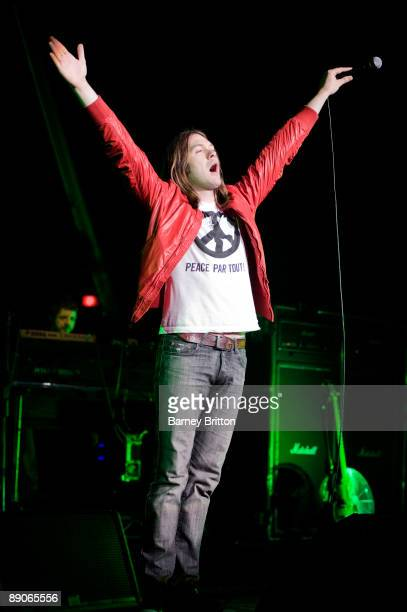 Tom Meighan of Kasabian performs on stage at Brixton Academy on July 16 2009 in London England