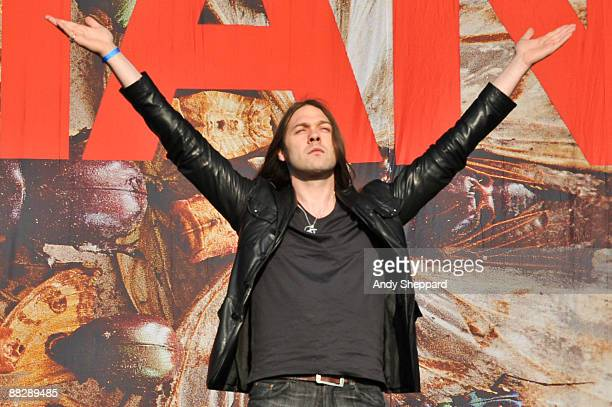 Tom Meighan of Kasabian performs on stage at Heaton Park on June 4 2009 in Manchester England
