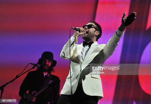 Tom Meighan of Kasabian performs on the Pyramid stage during day three of the Glastonbury Festival at Worthy Farm in Pilton on June 29 2014 in...