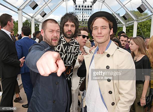 Tom Meighan Serge Pizzorno and Sam Claflin attend the front row at Burberry Menswear Spring/Summer 2016 show at Kensington Gardens on June 15 2015 in...