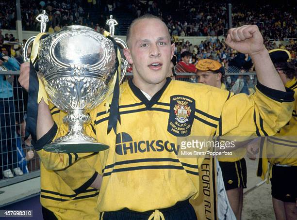 Tom Merchant of Castleford holds the Rugby League Challenge Cup after defeating Hull Kingston Rovers at Wembley Stadium in London by a score of 1514...