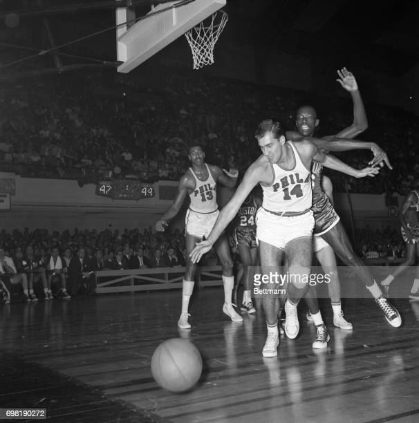 Tom Meschery of the Warriors wants the loose ball all to himself as he blocks off Boston's Tom Sanders in 1st quarter here 11/23 At left is Warrior...