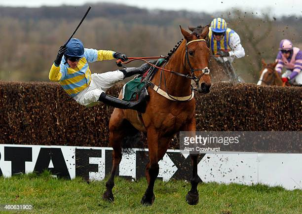 Tom Messenger riding Legendary Hop is unseated at the last in The Free Tips Every Day On ggcom Handicap Steeple Chase at Towcester racecourse on...