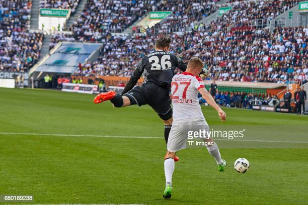 Tom Mickel of Hamburg klaert vor Alfred Finnbogason of Augsburg battle for the ball during the Bundesliga match between FC Augsburg and Hamburger SV...
