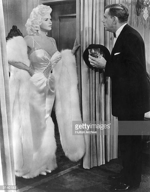 Tom Miller played by Tom Ewell meets his new client Jerri Jordan played by Jayne Mansfield A scene from 20th Century Fox's film 'The Girl Can't Help...