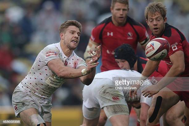Tom Mitchell of England gets a pass away against Canada during the Cup Semifinal match between England and Canada on day two of the Tokyo Sevens...