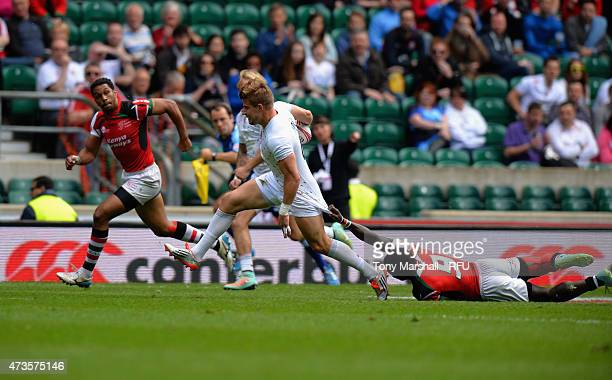 Tom Mitchell of England tackled by Michael Wanjala of Kenya during the Pool match between England and Kenya on Day One of the Marriott London Sevens...