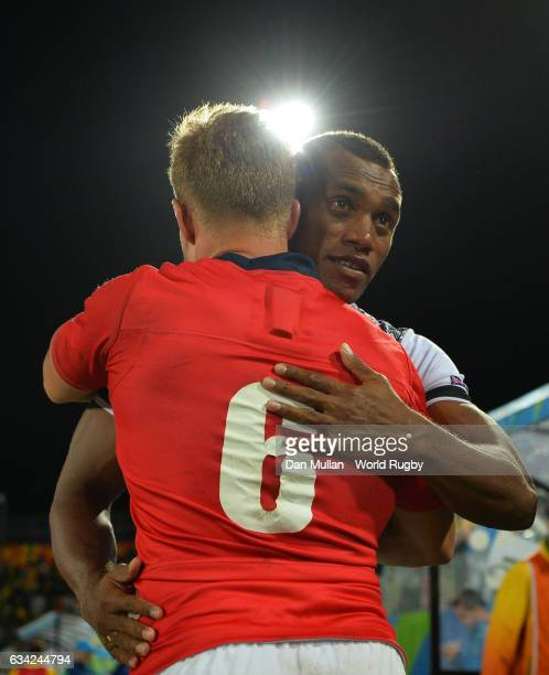 Tom Mitchell of Great Britain embraces Osea Kolinisau of Fiji following the Men's Rugby Sevens Gold Medal match between Fiji and Great Britain on day...