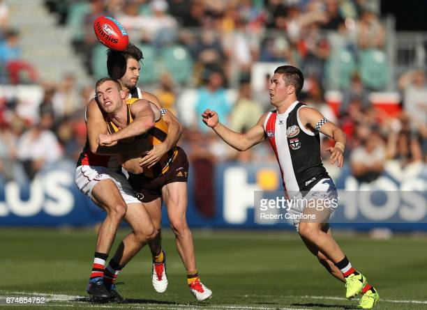Tom Mitchell of the Hawks gets his handball away during the round six AFL match between the Hawthorn Hawks and the St Kilda Saints at University of...