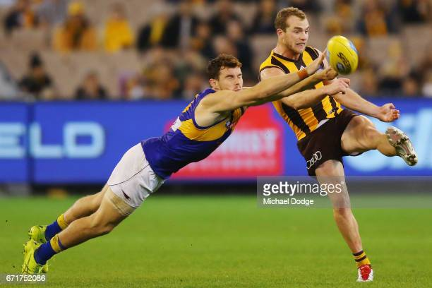 Tom Mitchell of the Hawks kicks the ball Luke Shuey of the Eagles during the round five AFL match between the Hawthorn Hawks and the West Coast...