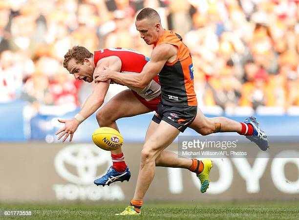 Tom Mitchell of the Swans and Tom Scully of the Giants compete for the ball during the 2016 AFL First Qualifying Final match between the Sydney Swans...