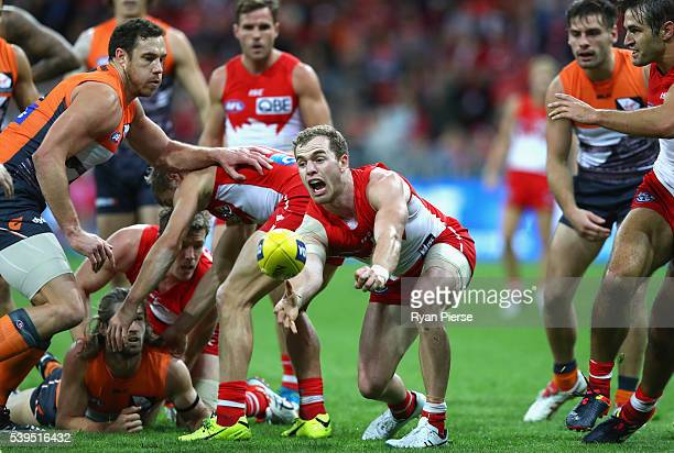 Tom Mitchell of the Swans gets a handball away during the round 12 AFL match between the Greater Western Sydney Giants and the Sydney Swans at...