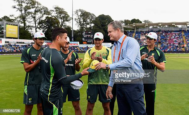 Tom Moody presents Marcus Stoinis with his cap before his T20 debut before the NatWest T20 International match between England and Australia at...