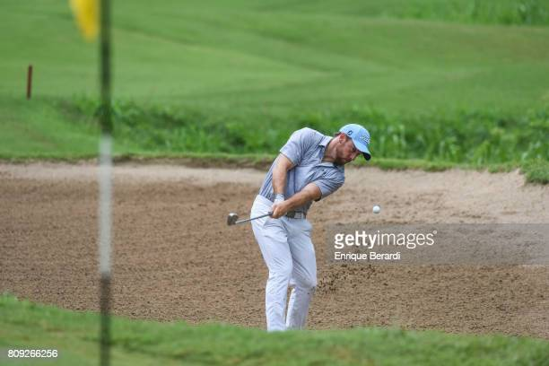 Tom Moore of the United States hits out of a bunker on the 17th hole during the third round of the PGA TOUR Latinoamerica BMW Jamaica Classic at...