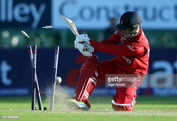 Tom Moores of Lancashire Lightning is bowled out by Jimmy Neesham of Derbyshire Falcons during the NatWest T20 Blast between Derbyshire Falcons and...