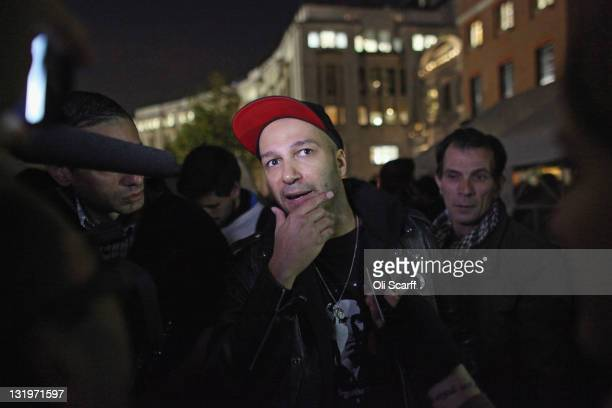 Tom Morello a guitarist with the band 'Rage Against the Machine' addresses protesters outside St Paul's Cathedral after students took part in a...