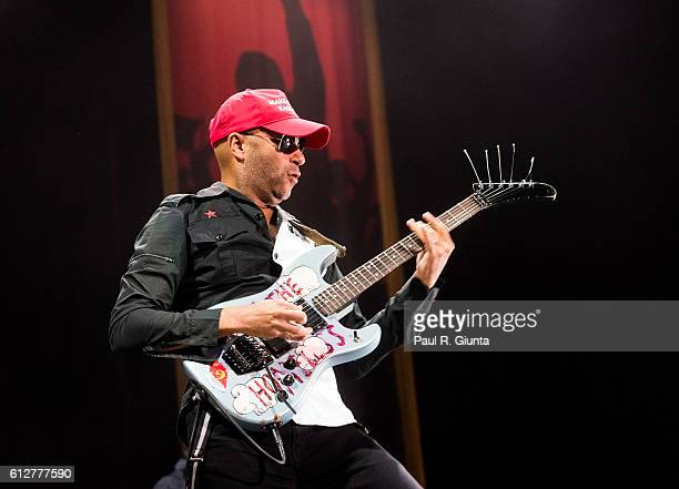 Tom Morello of Prophets of Rage performs on stage at Verizon Wireless Amphitheater on October 4 2016 in Alpharetta Georgia