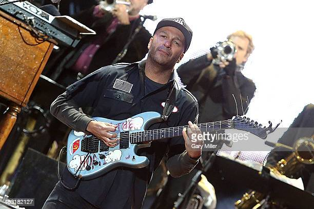 Tom Morello performs in concert with Bruce Springsteen and the E Street Band during the NCAA's March Madness Music Festival at Reunion Park on April...