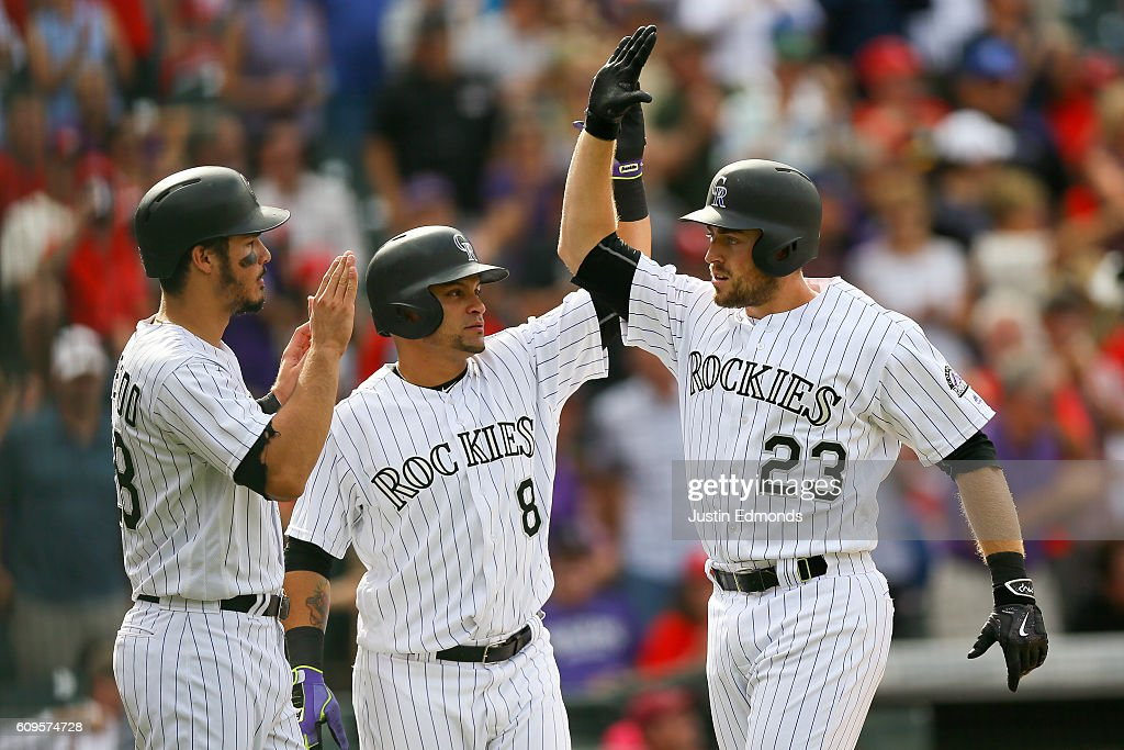 Tom Murphy #23 of the Colorado Rockies celebrates his three run home run with Gerardo Parra #8 and Nolan Arenado #28 during the seventh inning against the St. Louis Cardinals at Coors Field on September 21, 2016 in Denver, Colorado.