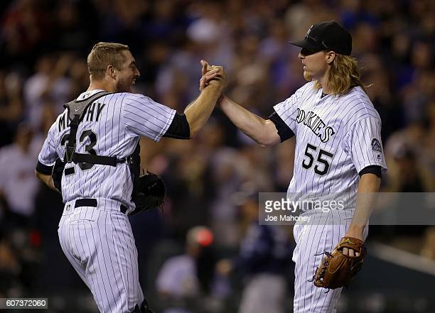 Tom Murphy of the Colorado Rockies congratulates Jon Gray of the Colorado Rockies after Gray's complete game shutout against the San Diego Padres at...