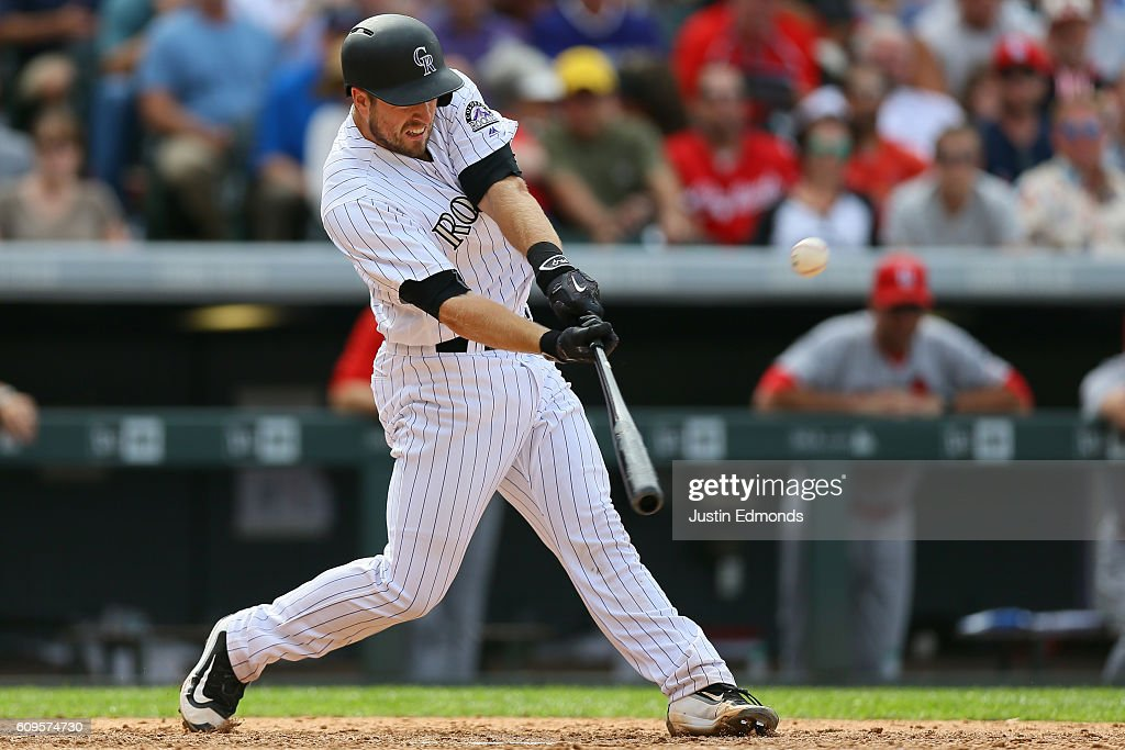 Tom Murphy #23 of the Colorado Rockies hits a three-run home run during the seventh inning against the St. Louis Cardinals at Coors Field on September 21, 2016 in Denver, Colorado.