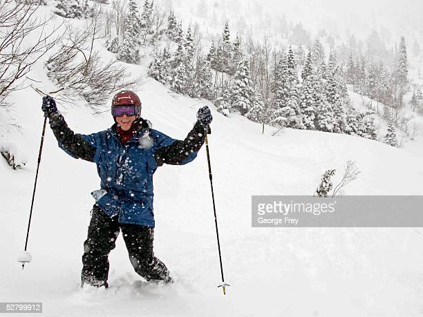 Tom Nagel of San Antonio Texas celebrates after he skied through almost two feet of new snow that blanketed the region May 11 2005 in Alta Utah There...