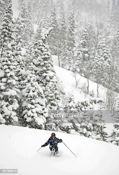 Tom Nagel of San Antonio Texas enjoys midwinter like ski conditions as he makes his way through almost two feet of new snow that blanketed the region...
