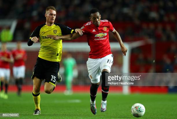 Tom Naylor of Burton Albion and Anthony Martial of Manchester United battle for possession during the Carabao Cup Third Round match between...